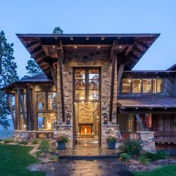 mountain modern diagonal wood siding exposed rafters stone